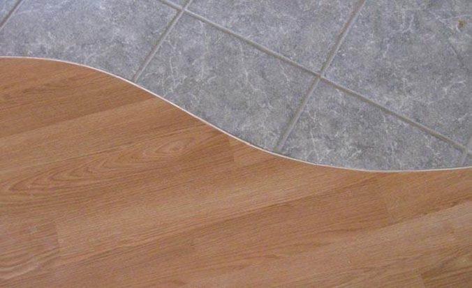 стыки между плиткой и ламинатом